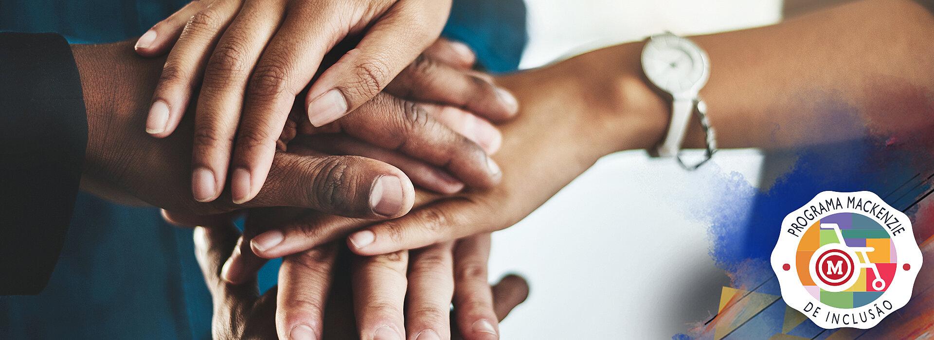 Selo do Programa Mackenzie de Inclusão: contém mãos sobrepostas