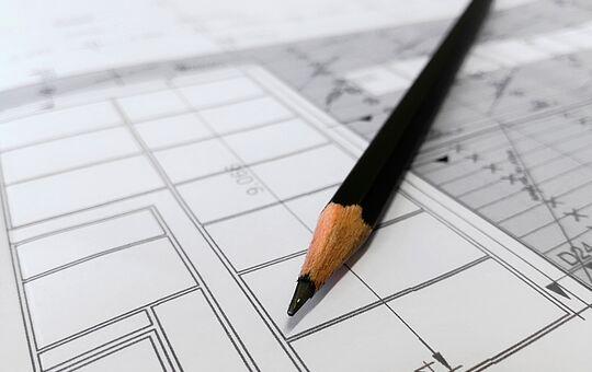 Projeto de arquitetura com lápis em cima